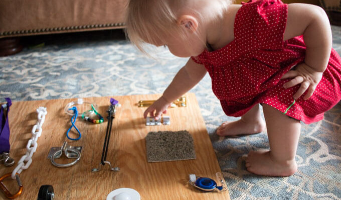 Should you mount your sensory board or lay it flat so kids can play with the latches? A guide to making your own tactile toys for your babies, toddlers, and kids.