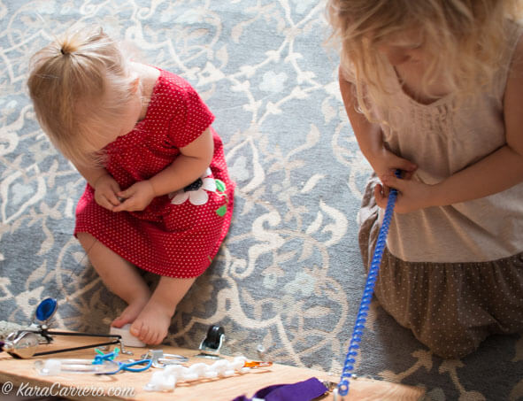 DIY Latch Board for toddlers, preschoolers, and even extension ideas for school aged kids to use it for cognitive development and critical thinking.
