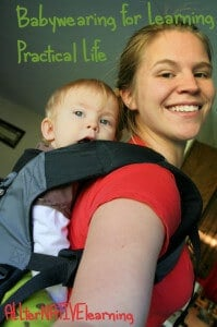 Babywearing for practical life and learning developmental skills.