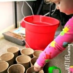 Toddler helping under the grow lights