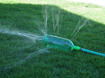 Plastic bottles can make great homemade sprinklers for play!
