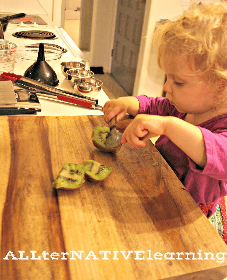 20 month old using two-handled knife
