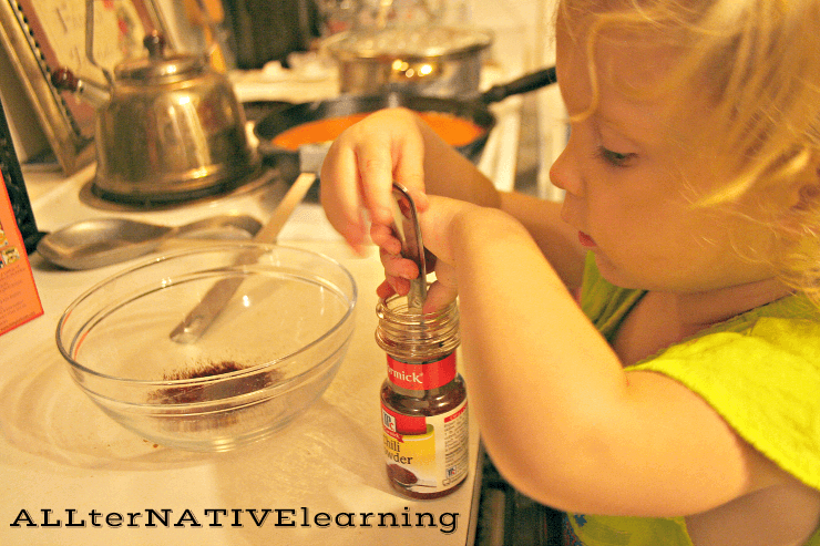 Toddlers can help cook dinner with scooping activities