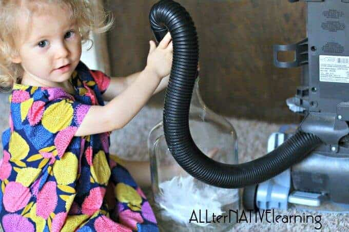 Using a vacuum and feather with a toddler to explain suction and pressure   ALLterNATIVElearning