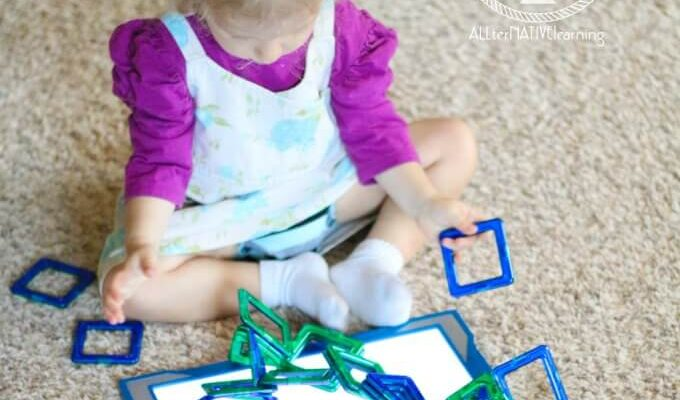 Toddler playing with magformers