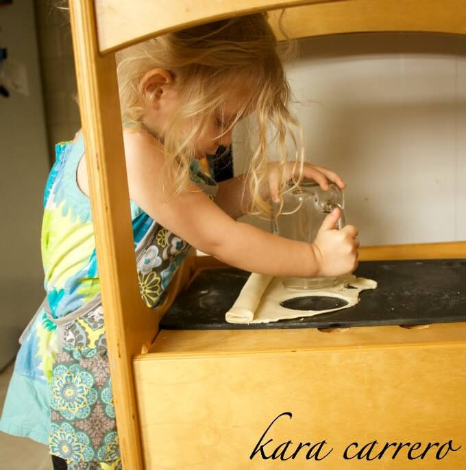 using learning tower as countertop to cook with kids