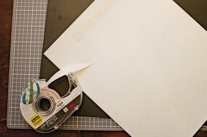 adhere double stick tape to back of photo paper