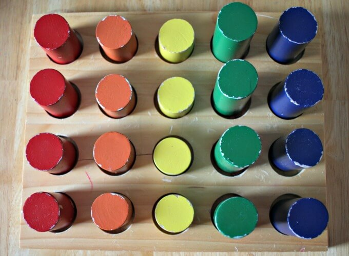 Using a montessori cylinder ladder to sort colors