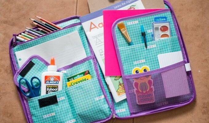 Organizing school supplies in a Yoobi Document pouch for young children.