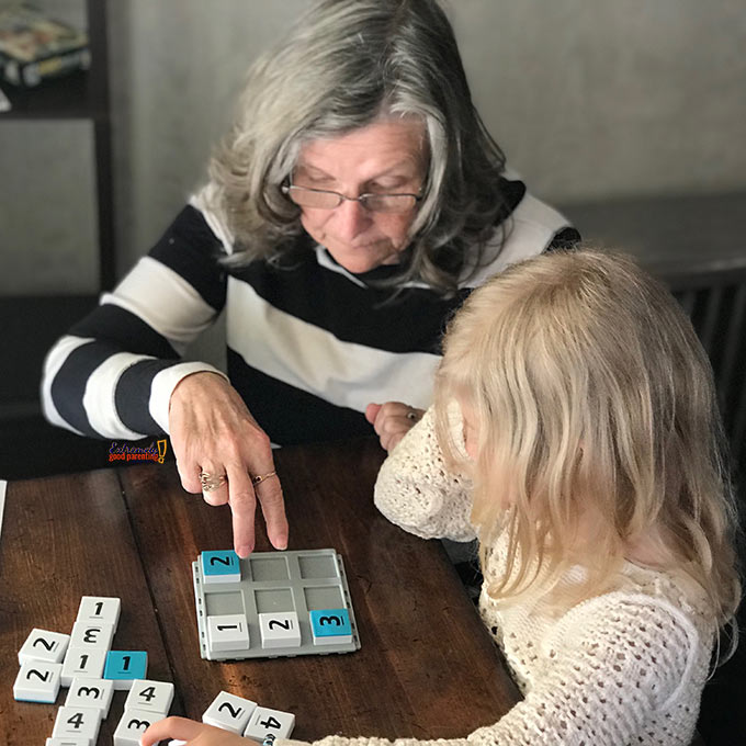 grandparent teaching sudoku to child