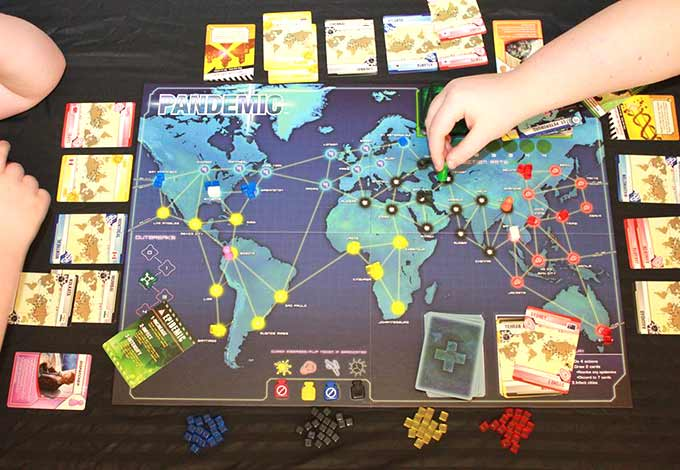 Pandemic board game and other cooperative board games.